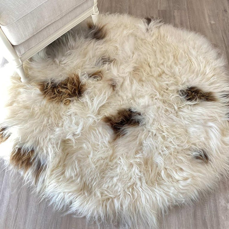 Add lush and inviting natural textures to a decor with this round, shaggy sheepskin rug. This enchanting shaggy rug features a long wool wile up to 5 inches length with exquisite natural brown spots in a delicious range of golden caramel