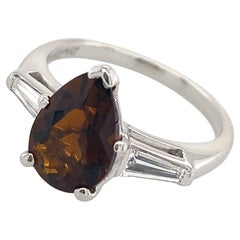 Brown Tourmaline Pear in Classic Platinum 3-Stone Ring with Diamond Baguettes