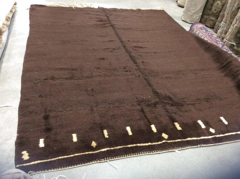 Brown vintage Moroccan rug.