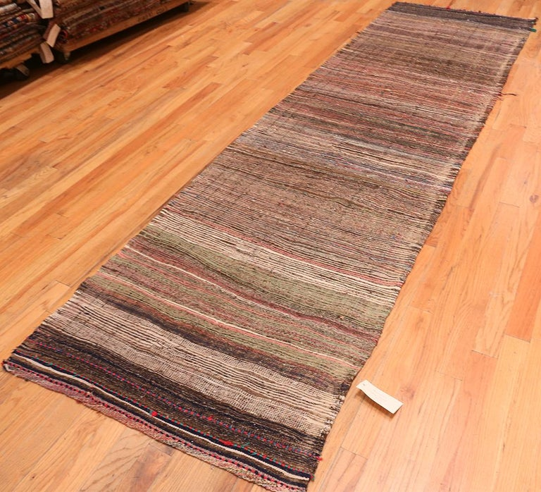 20th Century Brown Vintage Persian Kilim Runner Rug. Size: 3 ft 7 in x 12 ft 5 in For Sale