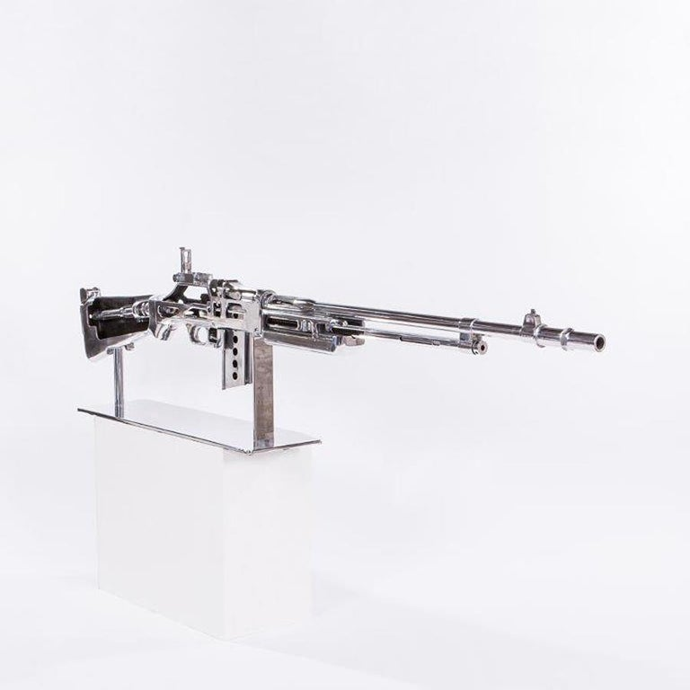 Rifle chrome browning double size, browning automatic Rifle. This is a twice life-size cutaway training model and was made in Chicago in the late 1940s. Powerful semi and fully automatic Rifle used by the American Army and designed by Robert