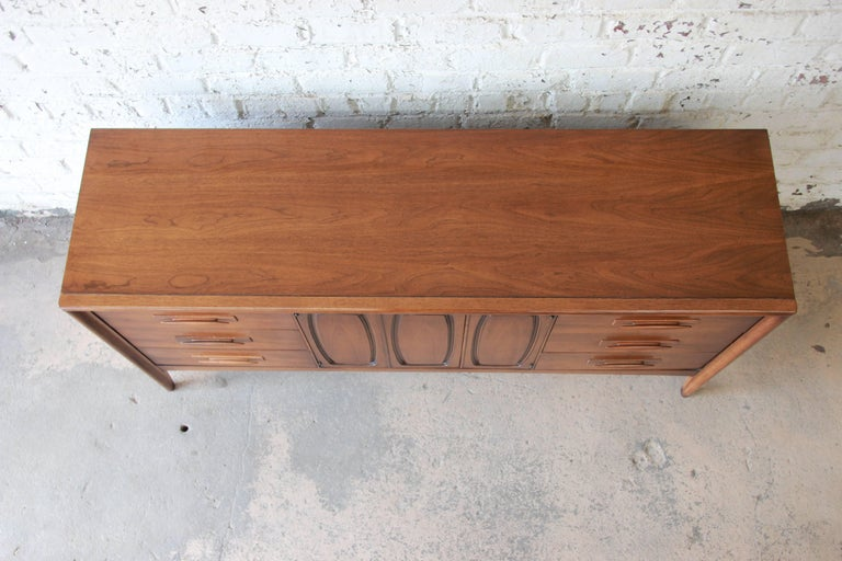 Broyhill Emphasis Mid-Century Modern Sculpted Walnut Credenza or Triple Dresser For Sale 6
