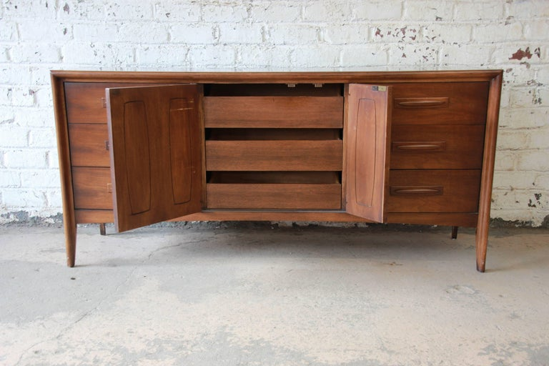 Broyhill Emphasis Mid-Century Modern Sculpted Walnut Credenza or Triple Dresser For Sale 2