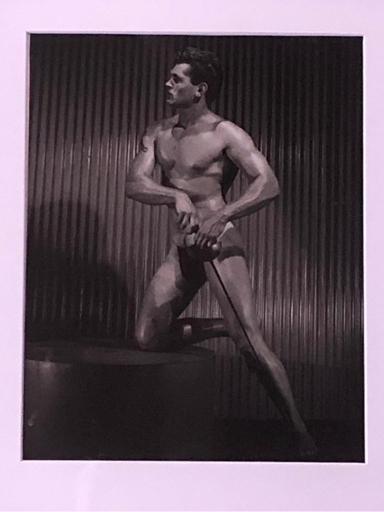 From an important collection of male physique and beefcake photography, image #2 of male model. (name unknown) Printed in the 1960s and are all signed by the studio when Mr. Bruce Bellas aka Bruce of LA was alive. Beautifully, professionally framed.