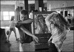 Brooklyn Gang Kathy fixing her hair in a cigarette machine mirror, Coney Island