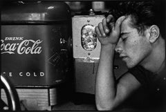 Young Man and Coca-Cola Machine - Black and White Photography, Mid-Century, USA