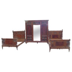 Bruce Talbert for Gillow a Walnut, Amboyna, Ebonised and Gilt Bedroom Suite