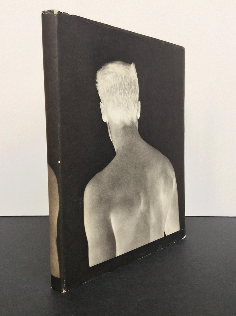 A beautifully conceptualized book of portraits by the photographer Bruce Webber. This hardbound book was published by Twelvetrees Press in 1983. The cover is elegantly wrapped in blue linen and protected by a dust jacket. Webber's photographs are
