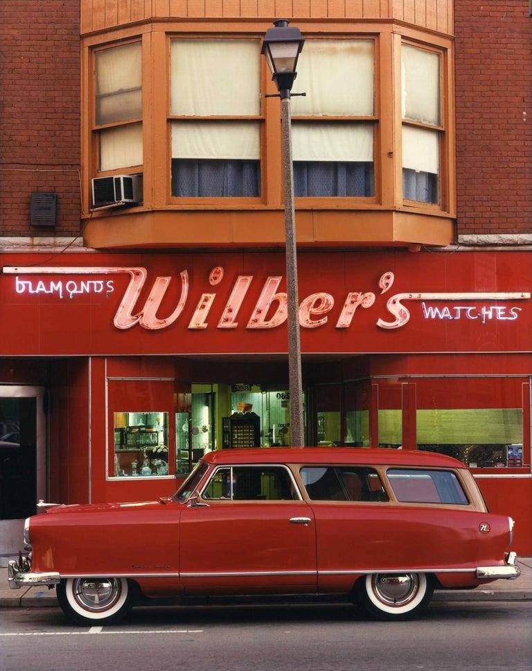 Bruce Wrighton Color Photograph - 1953 Nash Rambler, Wilber's Jewelers, Johnson City, NY