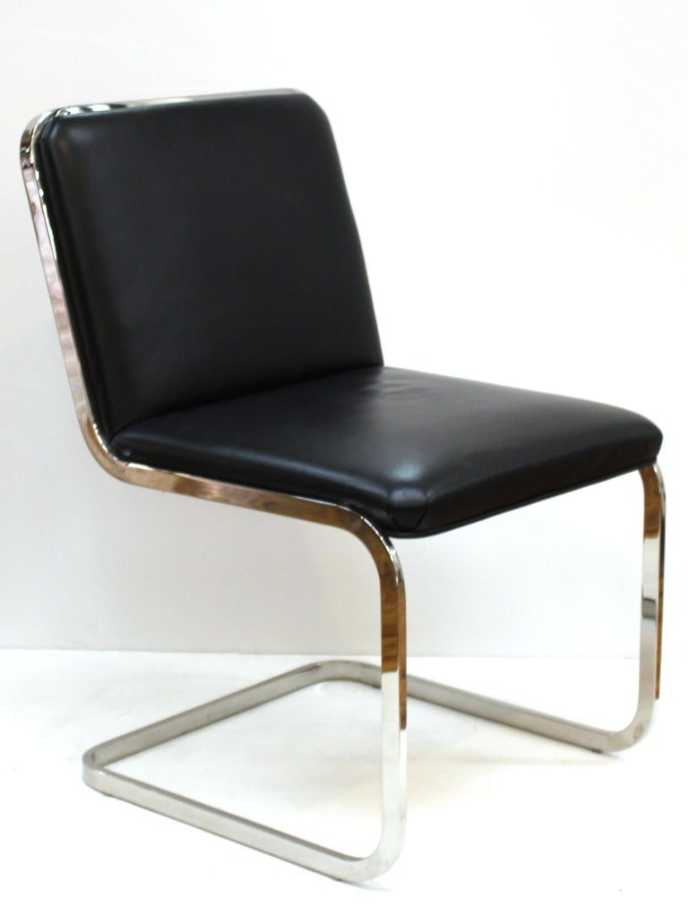 Brueton Mid-Century Modern set of four chromed metal cantilevered dining chairs with leather upholstery. Makers tag on the bottom, circa 1970s. In great vintage condition with age-appropriate wear.