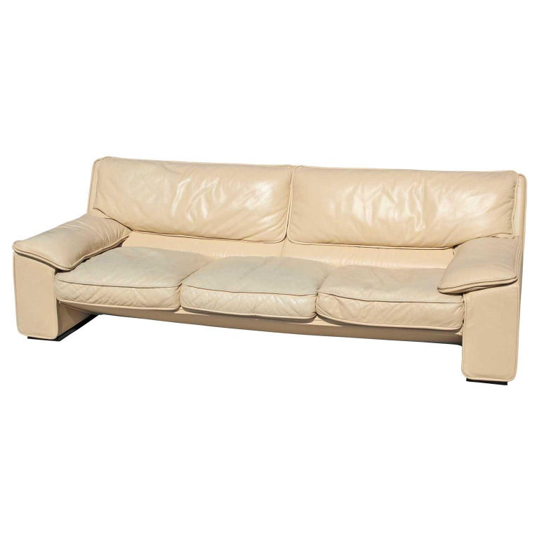 Brunati Italian Postmodern cream leather three-seat sofa. Our leather specialist can restore the imperfections for around $900 if desired.  Measures: H 30 x W 90 x D 35 SH 14.
