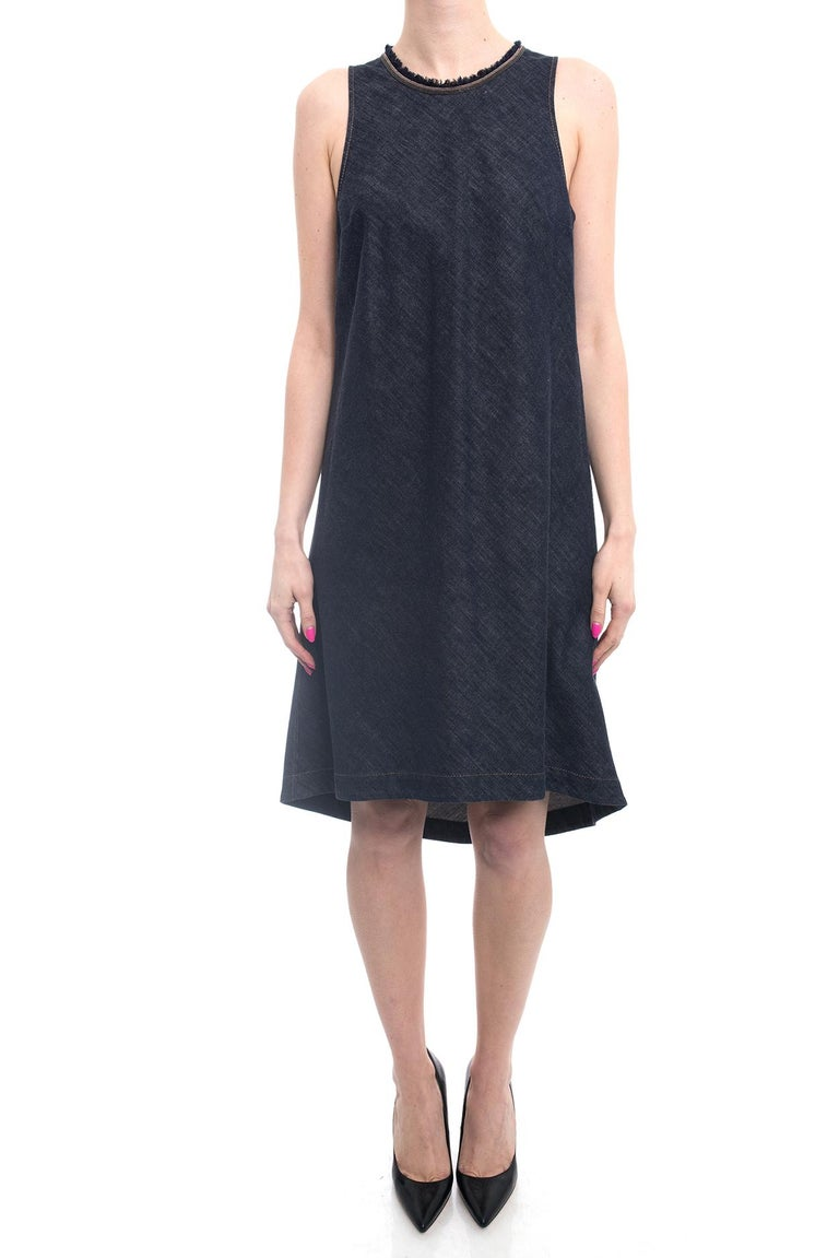 Brunello Cucinelli Denim Monili Bead Trim Sleeveless Dress.  Bias cut dark blue denim dress with bead trim fringe neckline and a-line silhouette.  Rounded hem, pullover design with back neck zipper and bead trim zipper pull. Marked size L (fits USA