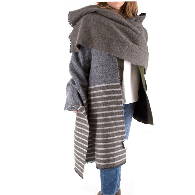 Brunello Cucinelli Grey Cashmere Striped Scarf  -Large grey scarf with light grey stripes and green accents -Raw hem at ends -Scarf features stripes of varied sizes   Approx.  Length - 230cm Width - 72cm  Cashmere, Mohair, Alpaca and Polyamide