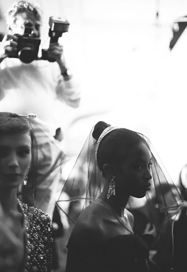 Bruno Bisang Black and White Photograph - Helmut Newton shooting Naomi Campbell at Dior