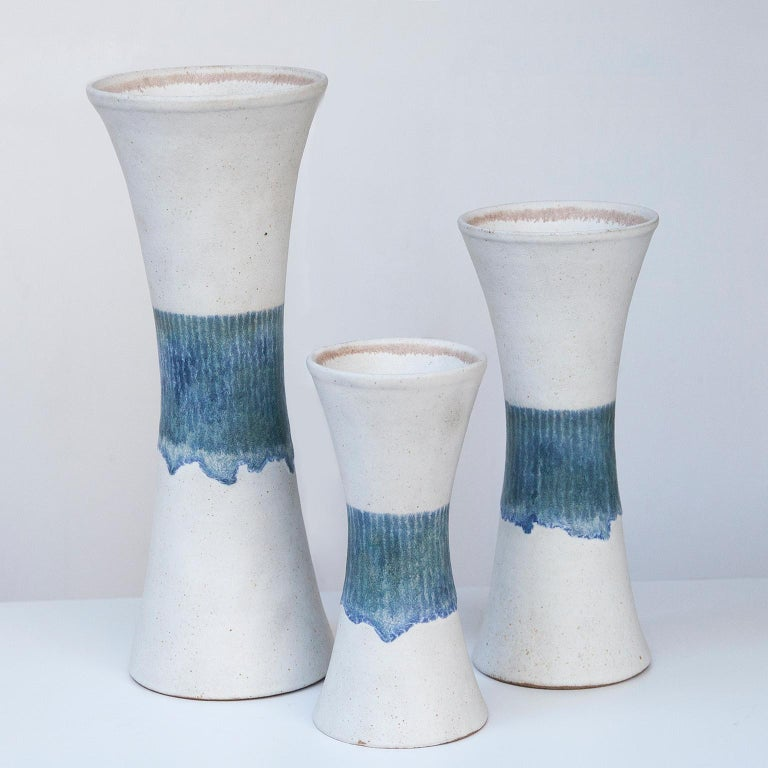 Bruno Gambone set of three vase in white and blue stoneware Italy 1970s, signed Gambone, Italy.  40 H x 16 D, 31 H x 13 D, 24 H x 11 D cm.