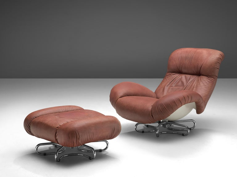 Bruno Gecchelin for Busnelli, lounge chair and ottoman, leather, fiberglass, chromed metal, Italy, 1972  This great, rare lounge chair with matching ottoman designed in 1972 by Bruno Gecchelin for Busnelli, comes in its original red leather