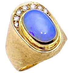 Bruno Guidi 0.76 Carat Oval Cabochon Opal and Diamond 18 Karat Yellow Gold Ring