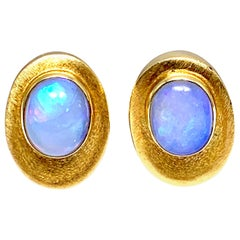 Bruno Guidi 3.65 Carat Oval Cabochon Opal and 18 Karat Yellow Gold Clip Earrings