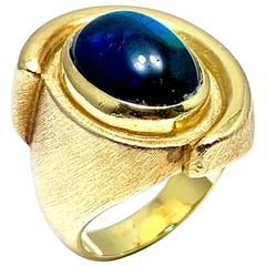 Bruno Guidi 6.43 Carat Cabochon Indicolite Tourmaline 18 Karat Yellow Gold Ring