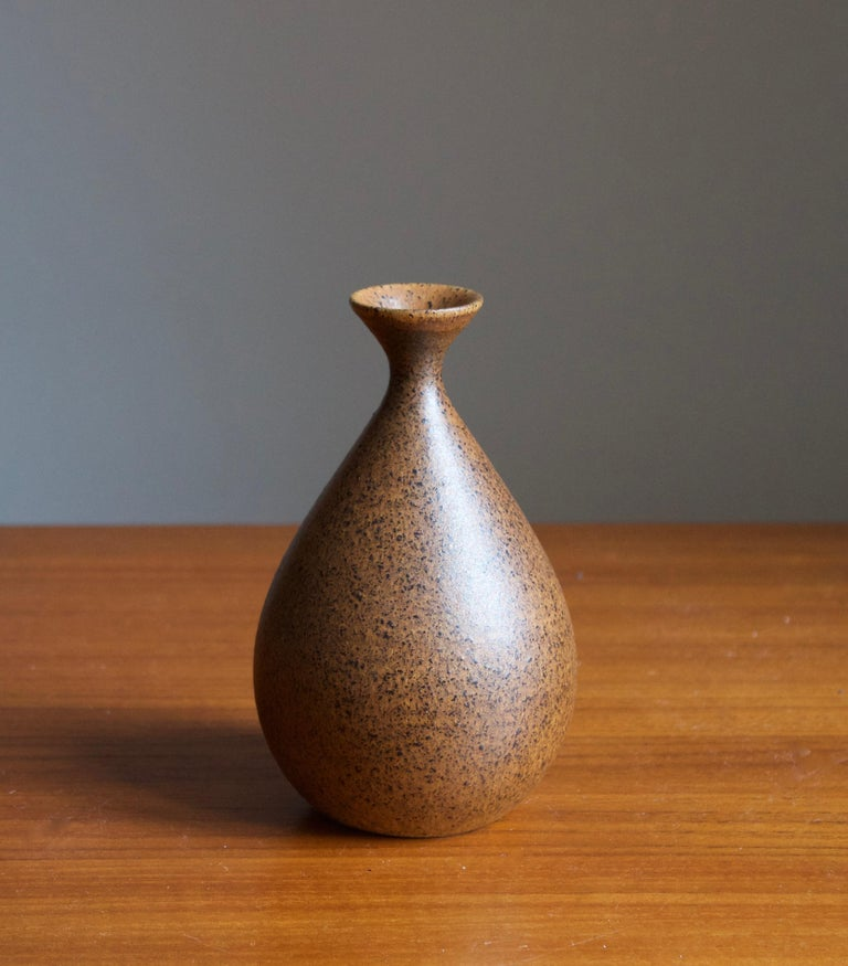 A small handmade stoneware vase, executed by Bruno Karlsson in abstract form and highly artistic brown glaze. In his Studio, called