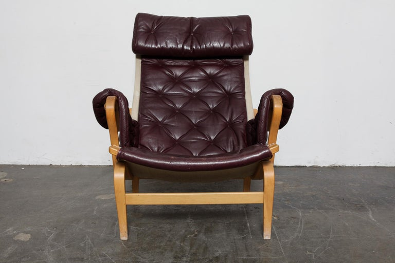 Swedish Bruno Mathsson Eggplant Colored Tufted Leather