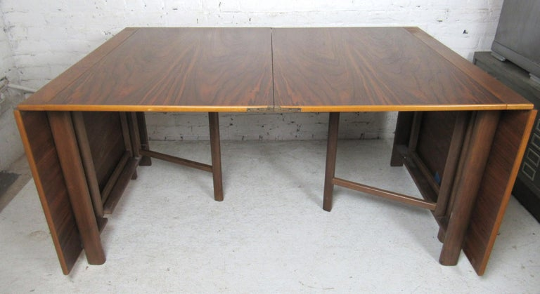 Danish modern drop elaf table that opens up to 109