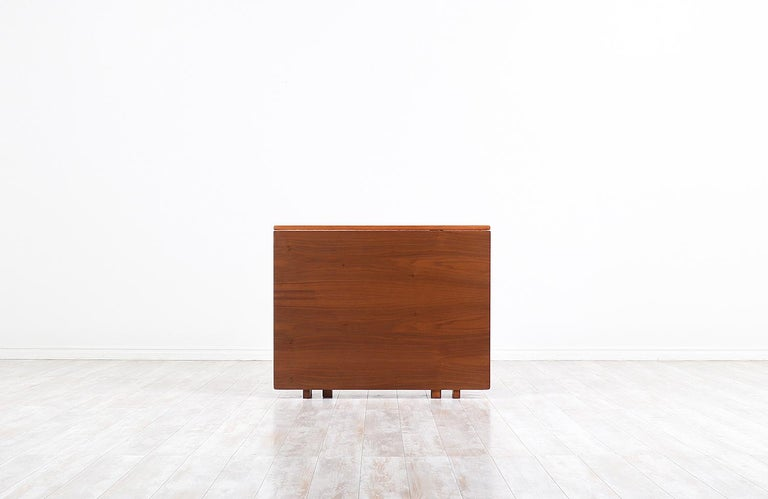 """Stunning modern """"Maria Flap"""" dining table designed by Bruno Mathsson for Karl Mathsson in Sweden, circa 1930s. This iconic Swedish Modern design features a stunning walnut wood top, a solid walnut-stained beechwood base, and brass hardware to give"""