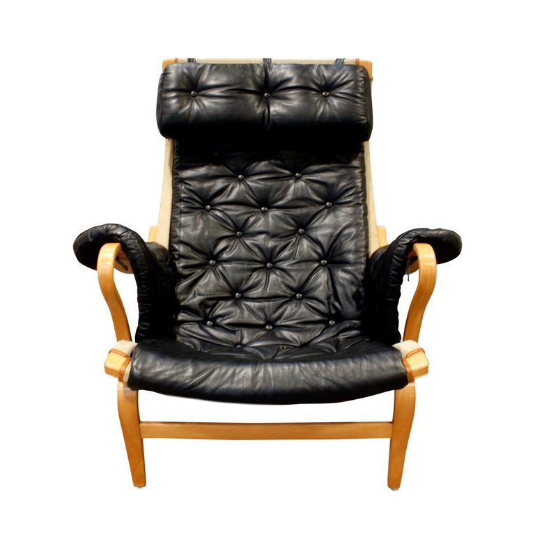 """Pernilla lounge chair in molded beech plywood with canvas and tufted black leather by Bruno Mathsson for DUX, Sweden 1969. Signed """"Bruno Mathsoon by DUX"""" on bottom back leg. This chair is in remarkable condition."""