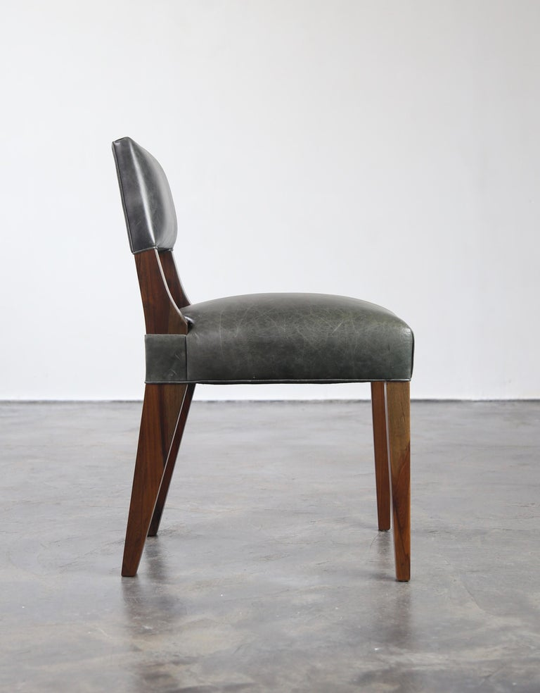 A signature chair by Costantini, our Bruno chair features a low-profile, ergonomically-designed back. Available as shown in argentine rosewood and leather or in custom materials, finishes and the upholstery material of your choice. Also available as