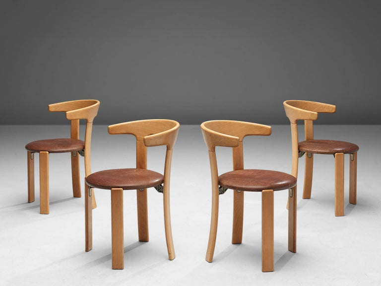 Bruno Rey for Kush & Co, set of five dining chairs, leather and beech, Switzerland, 1971.  This set of dining chairs is designed by Bruno Rey in Switzerland in 1971 and is very comfortable. The chairs are also stackable and were produced in