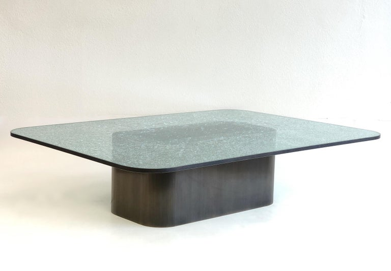 A spectacular 1980s large brushed bronze and crackle glass cocktail table by Renowned designer Steve Chase. 