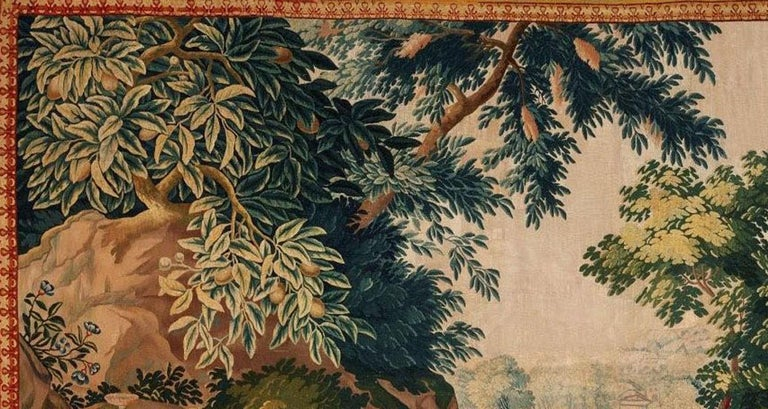 Brussels 18th century Bacchanale Tapestry, circa 1760. A Brussels tapestry early 18th century. A Bacchanale scene of young children drinking from wine barrels under a canopy of leafy trees with colorful flowers. A tall stately mansion rises up in