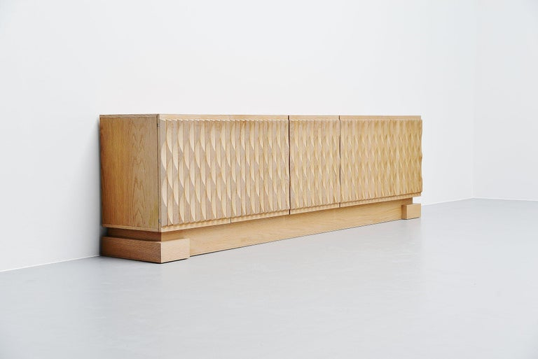 Beautiful Brutalist shaped sideboard/credenza made in Belgium 1970. In the 1970s some Belgian factories and little cabinet makers produced these Brutalist shaped cabinets and sideboards. Most of them with graphical designed doors in different shapes