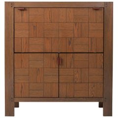 Brutalist Bar Cabinet with leather handles in Stained Oak