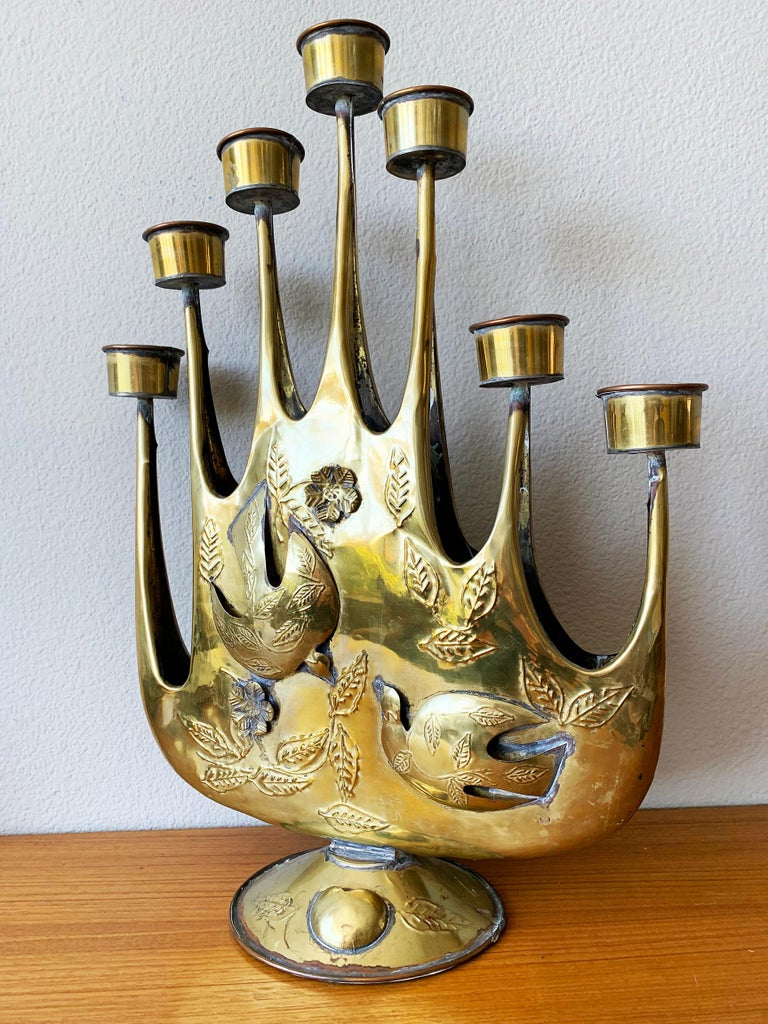 An increasingly rare and beautiful brass plated Brutalist tin candelabra by Mexican artist Gene Byron. handmade, hammered tin with lovely detail. This beautiful piece was also featured in the Verna Cook Shipway Mexican modernism design books of the