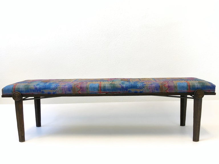 """A spectacular Brutalist bronze bench designed for Steve Chase in the 1980s. The bench retains original fabric chosen by Steve Chase. The bench is constructed of solid aged bronze. Measurements: 66.25"""" wide, 18.75"""" deep, 18.5"""" high."""