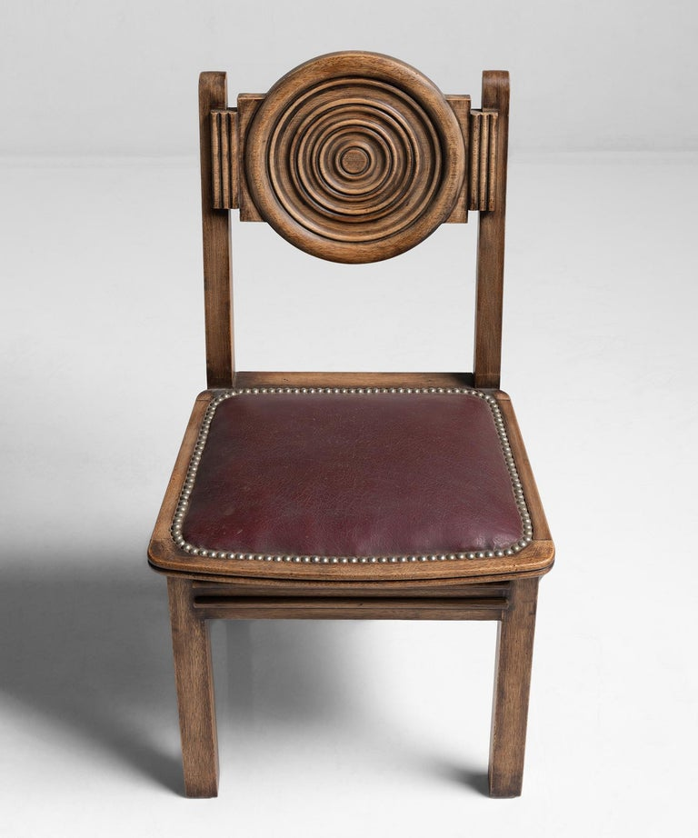 Side or dining chair, carved wood frame with rexine seat, in the style of Joseph Savina.