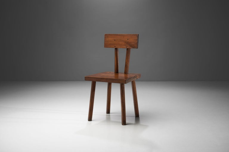 Brutalist handmade chair made of solid wood from circa 1950s. With a robust organic form and an earth-toned palette, this chair is the embodiment of Brutalism. The chair has a startling rawness, but with its warm-toned and slightly asymmetrical body