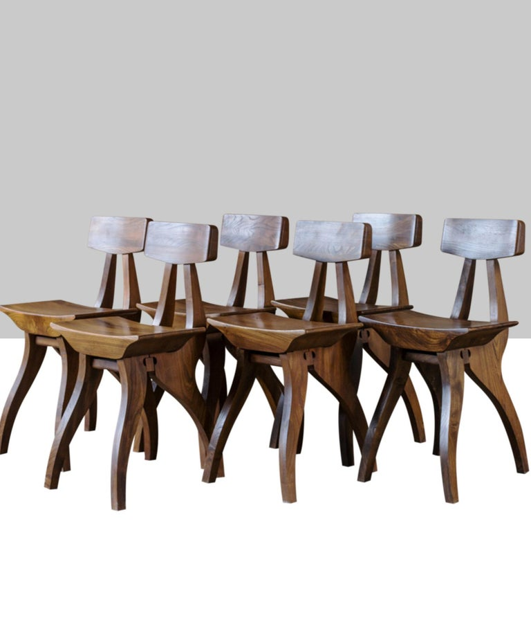 Hardwood chairs with unique form and construction.