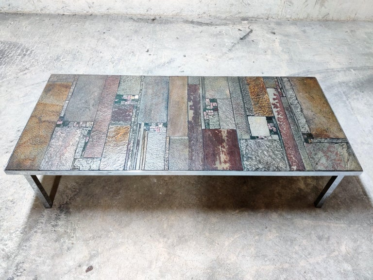 Brutalist coffee table designed by Pia Manu for Amphore.  The table consists of a chromed steel base with a handmade slate and tiled top.  Beautiful unique coffee table.  1960s, Belgium  Very good condition.  Measures: Height