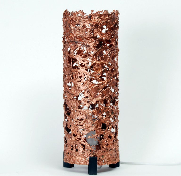 """Copper table lamps """"Moonlight"""", designed by Finnish sculptor Aimo Tukiainen in the late 60´s. The cylinder shape body of the lamp is made of melted copper with three feets of blackened wood. Rewired."""