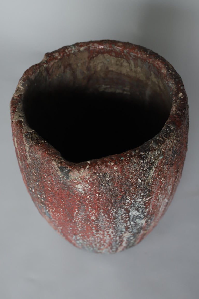 Large crucible with extraordinary texture and colors. Makes for a wonderful planter or pot.