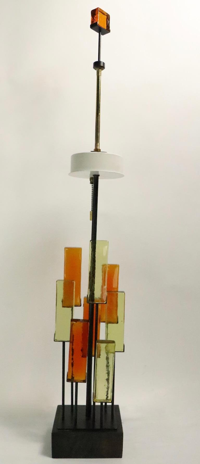 Rare glass block and wrought iron table lamp, design attributed to Gerald Thurston, for Lightolier. This example is in excellent original condition, clean, working and ready to use, it accepts three standard size screw in bulbs, which operate