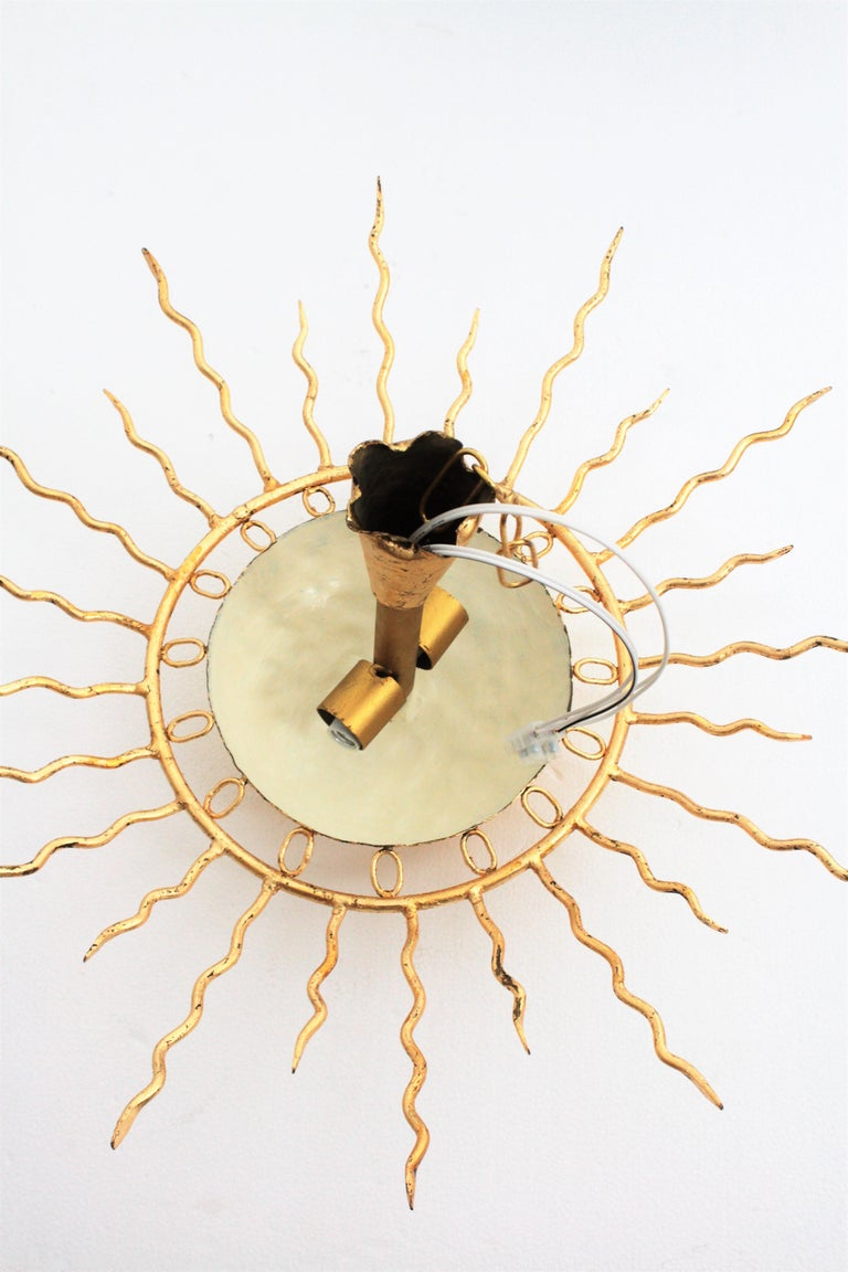 Brutalist Hand-Hammered Gold Gilt Iron Sunburst Light Fixture Framed By Circles For Sale 6