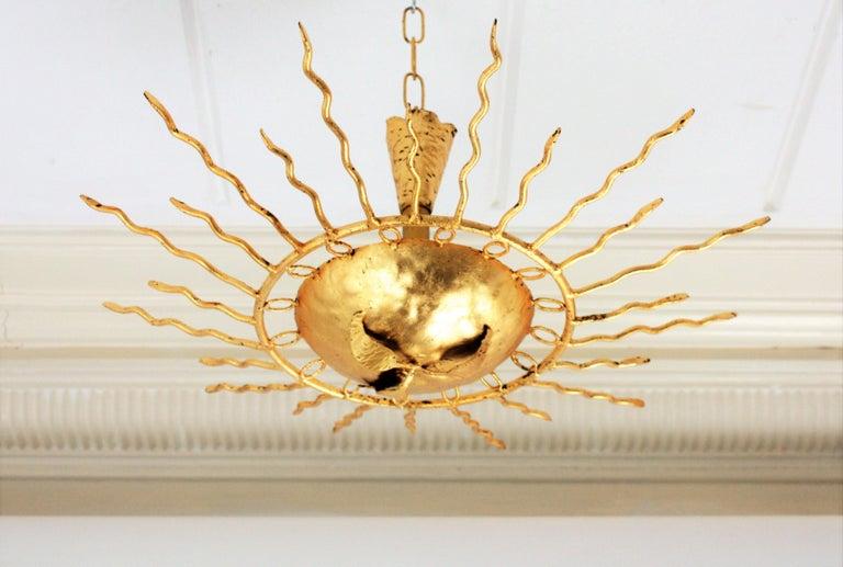 20th Century Brutalist Hand-Hammered Gold Gilt Iron Sunburst Light Fixture Framed By Circles For Sale
