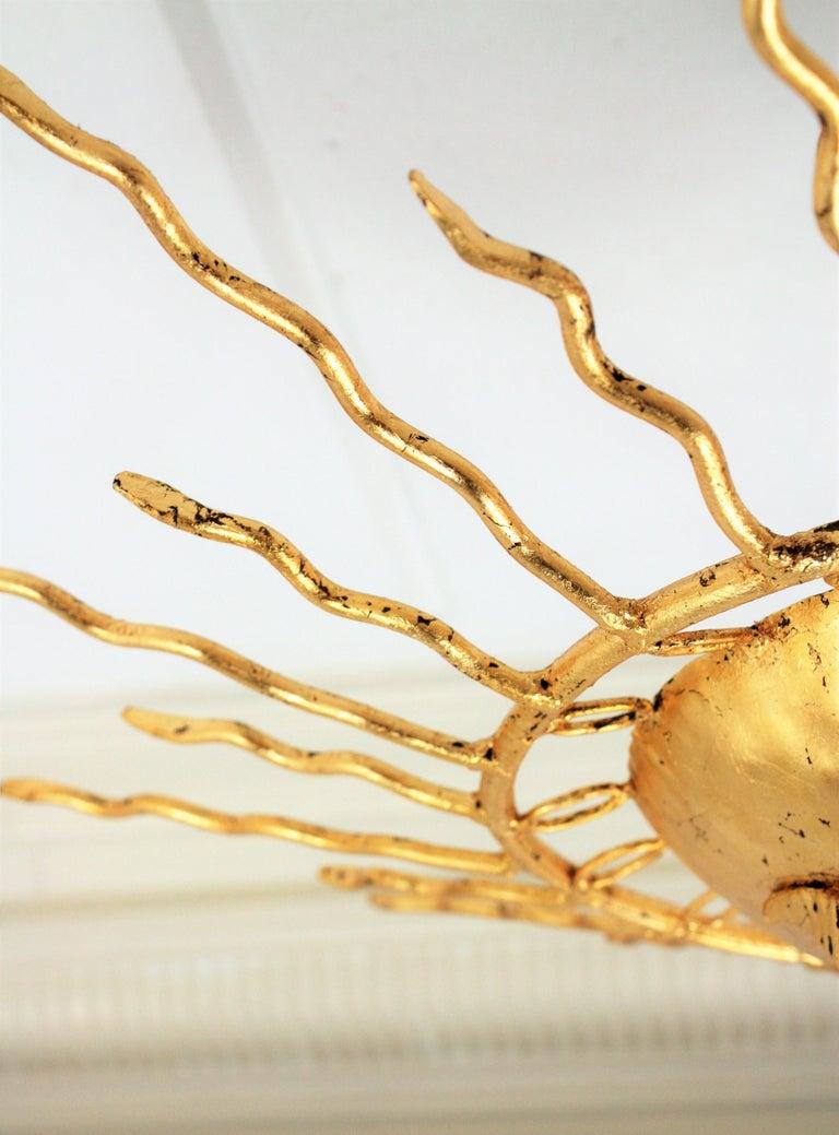 Brutalist Hand-Hammered Gold Gilt Iron Sunburst Light Fixture Framed By Circles For Sale 2