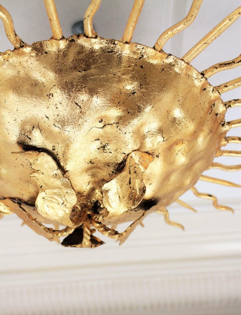 Brutalist Hand-Hammered Gold Gilt Iron Sunburst Light Fixture with Flower Detail For Sale 5