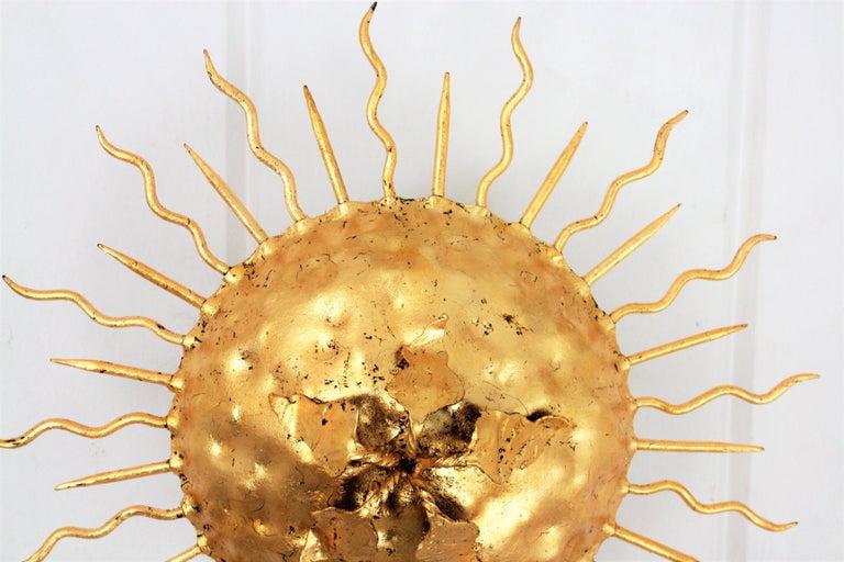 Spanish Brutalist Hand-Hammered Gold Gilt Iron Sunburst Light Fixture with Flower Detail For Sale