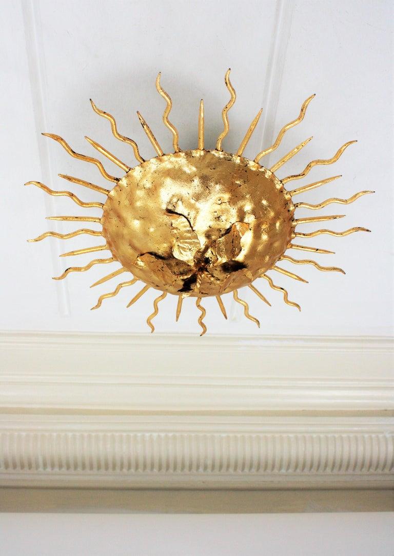 20th Century Brutalist Hand-Hammered Gold Gilt Iron Sunburst Light Fixture with Flower Detail For Sale