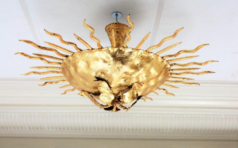 Wrought Iron Brutalist Hand-Hammered Gold Gilt Iron Sunburst Light Fixture with Flower Detail For Sale